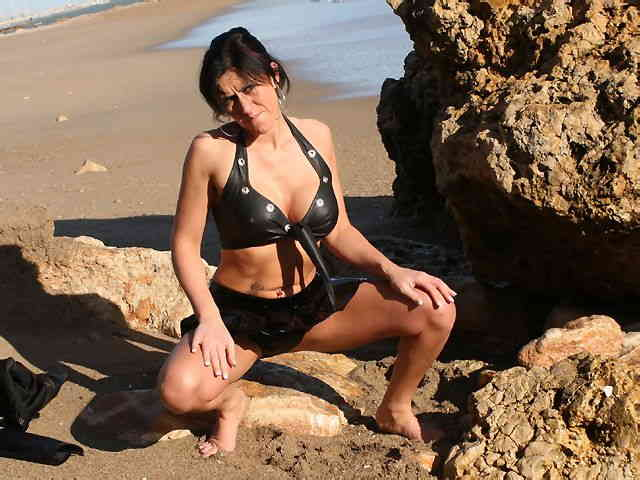 MILF brune geting nude at the beach  photo 02