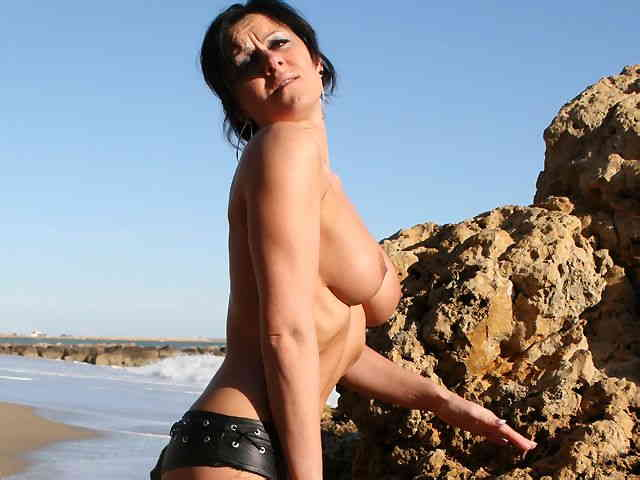 MILF brune geting nude at the beach  photo 05