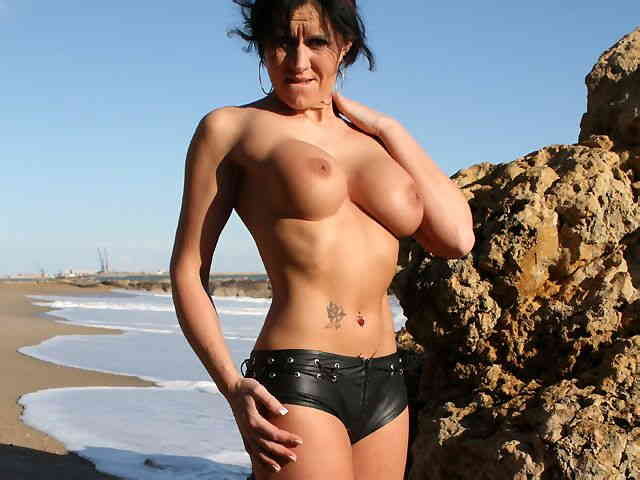 MILF brune geting nude at the beach  photo 06