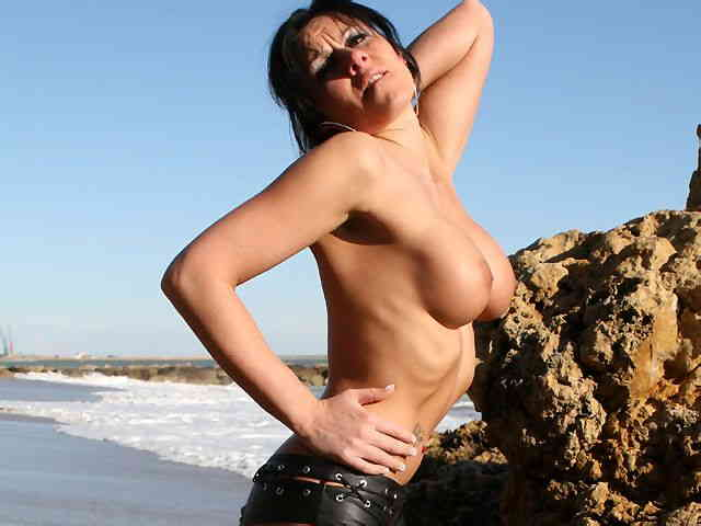 MILF brune geting nude at the beach  photo 07