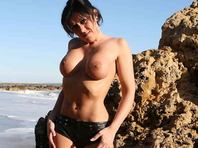 MILF brune geting nude at the beach  photo 08