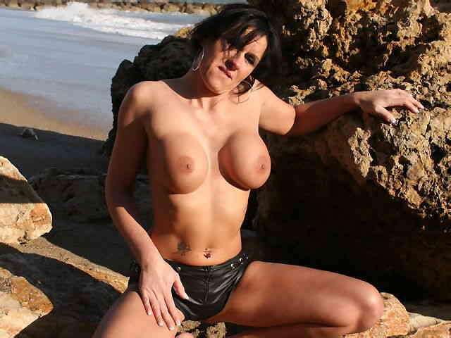 MILF brune geting nude at the beach  photo 10