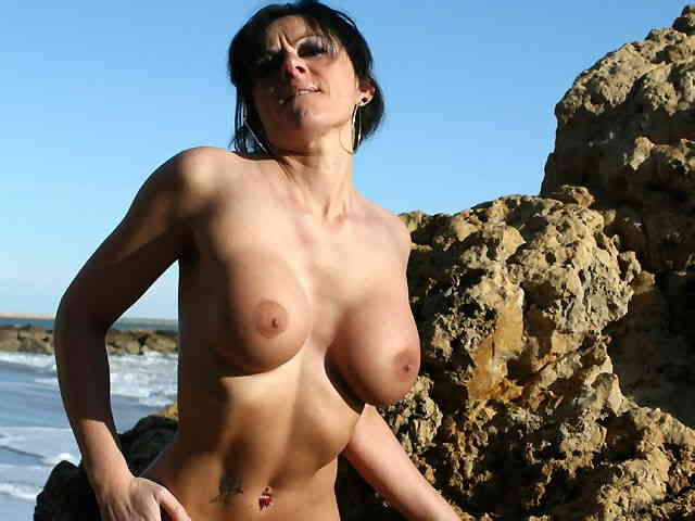 MILF brune geting nude at the beach  photo 12