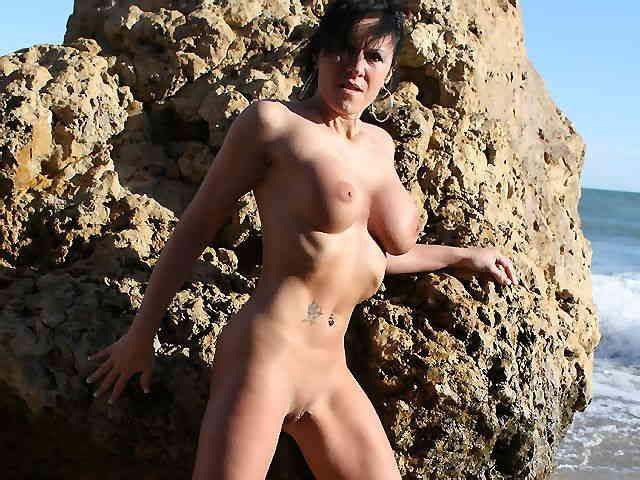 MILF brune geting nude at the beach  photo 14