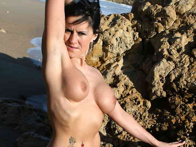 MILF brune geting nude at the beach  photo 15