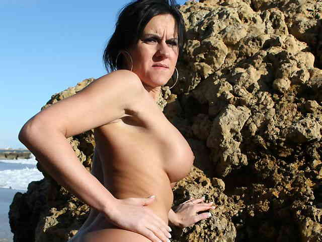 MILF brune geting nude at the beach  photo 16