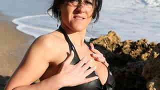MILF brune geting nude at the beach photo 1